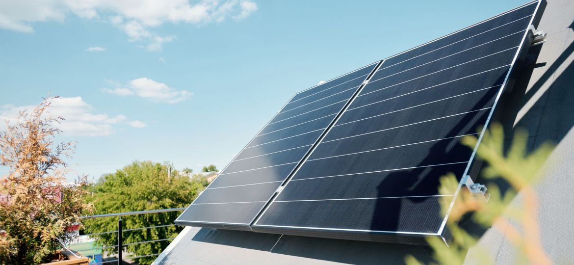 Large solar panels on rooftop of modern comfortable house or cottage